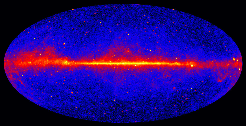 This view shows the entire sky in gammy ray radiation, at energies greater than 1 GeV, based on five years of data from the Large Area Telescope instrument on NASA's Fermi Gamma-ray Space Telescope. Brighter colours indicate brighter gamma-ray emission. The large bright band in the middle is the emission from our own Galaxy.