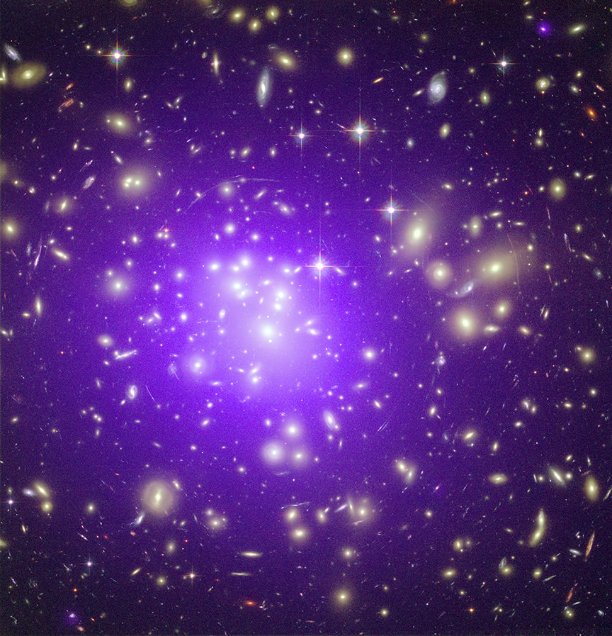 "<p>The Galaxy cluster ""Abell 1689"", located approximately 2 billion light years away, is one of the most massive clusters in the known Universe. This picture is a composite of an optical image, taken with the Hubble Space Telescope, and an X-ray observation with the Chandra Space Telescope. The former shows starlight from more than 1000 galaxies, the latter (in purple) the hundred-million-degree hot gas which permeates the space between galaxies and contributes more mass to the cluster than all its galaxies together.</p>"